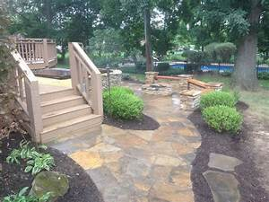 Flagstone patio with built in hot tub creative outdoor for Patio landscape design