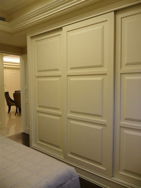 craftsman style home interiors sliding closet door bedroom with armchair bed skirt