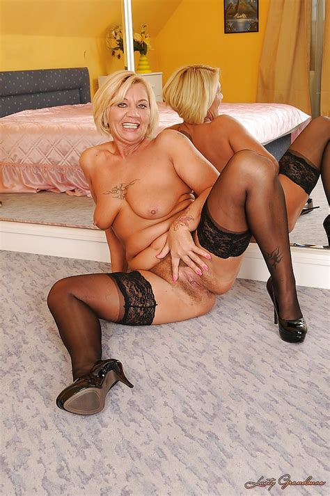 lusty mature blonde slipping off her dress and posing in