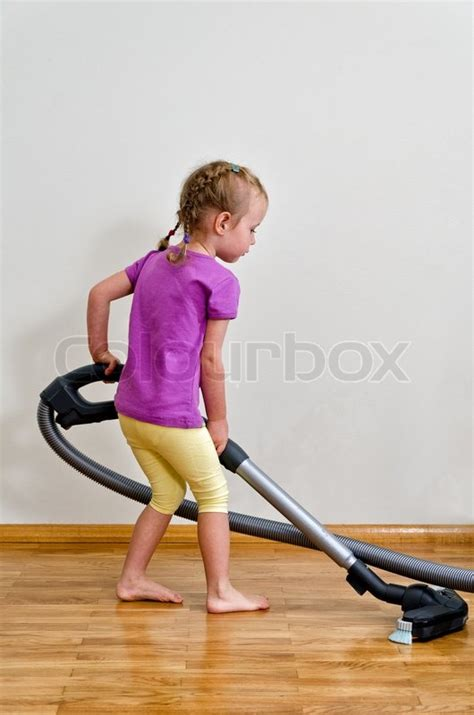 vacuuming floors cute little girl cleaning floor with vacuum cleaner stock photo colourbox