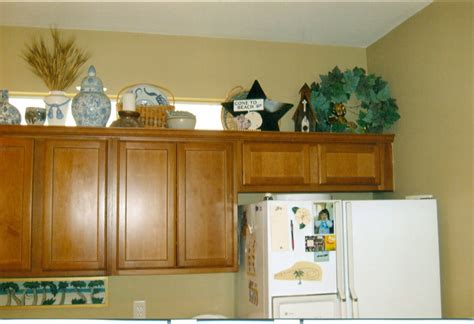 above kitchen cabinet ideas decorating above kitchen cabinets ideas afreakatheart