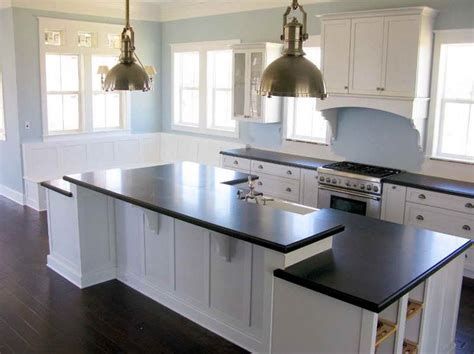 pictures of white kitchen cabinets with dark countertops
