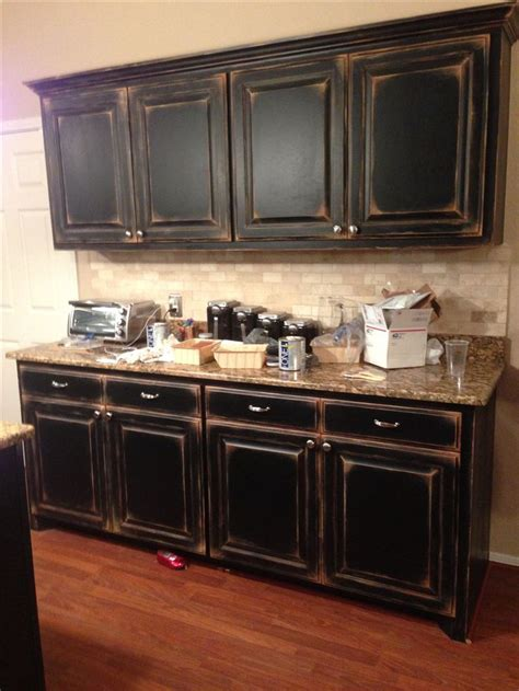 Black cabinets with faux distressing. Used 3 different