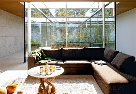 einrichten offenes wohnzimmer mit glas putz und stein