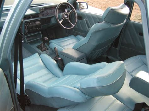 brok interieur holden to revive controversial brock director badge for