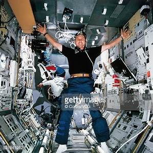 Astronauts Float Inside Space Shuttle During Experiment ...