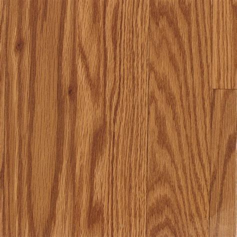 laminate wood flooring at lowes shop allen roth 7 48 in w x 3 93 ft l gunstock oak smooth wood plank laminate flooring at