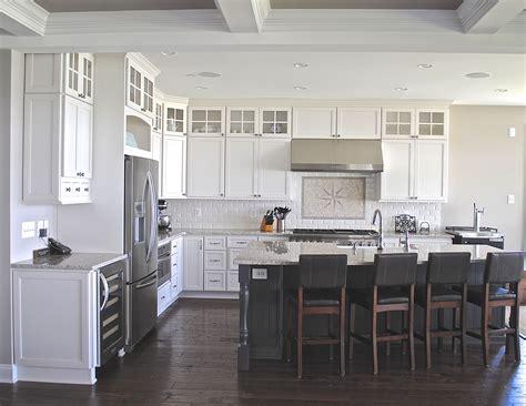 coastal white kitchen  dark grey island cabinets