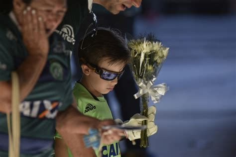 People Pay Tribute To The Brazilian Soccer Players In Santa Catarina Brazil On Thursday The