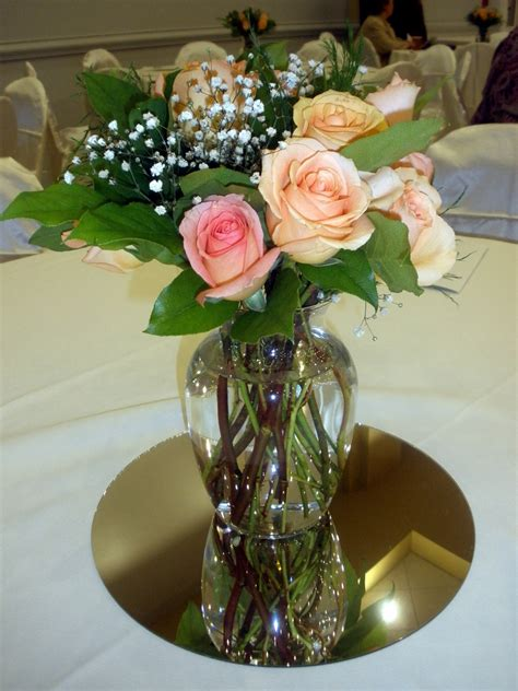 wedding centerpieces  fresh peach roses  greens