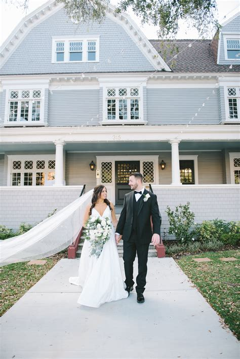 Romantic Classic Bride and Groom Outside Historic Wedding