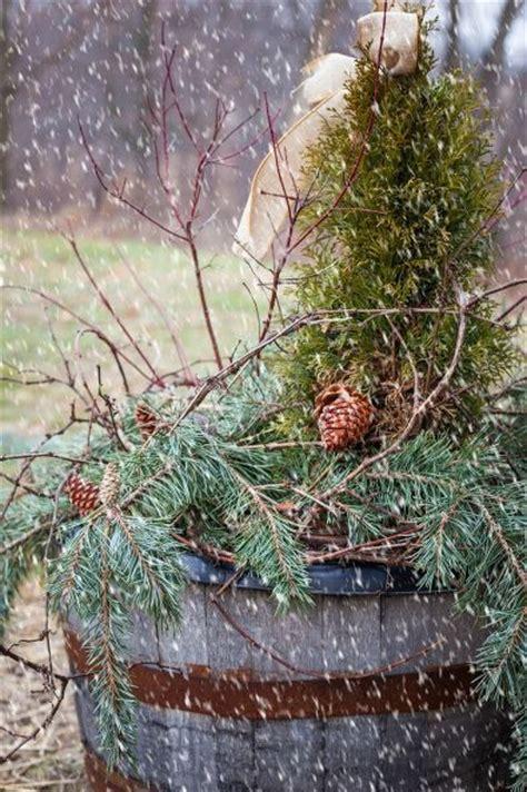 rustic christmas porch  whiskey barrel decor whiskey barrels porches  christmas