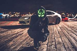 Person Wearing White And Green Mask With Led Beside White