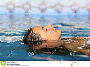 Woman Face Relaxing Floating On Water Of A Pool Or Spa ...