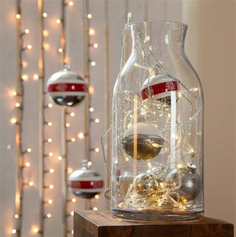glass vase filled  christmas lights  ornaments