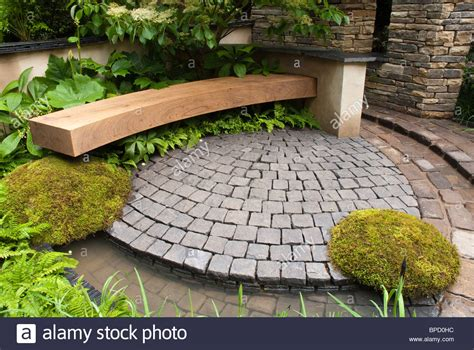 garden bench and patio in circular with moss