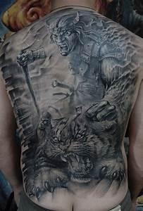 Fierce warrior killing a tiger tattoo on back ...
