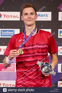 Denmark's Viktor Axelsen on the podium after winning gold ...