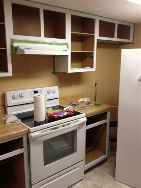 how to paint inside kitchen cabinets painting the kitchen cabinets part 2 planitdiy