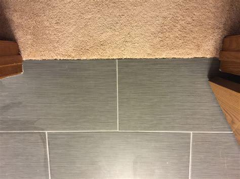 tile doorway threshold header board at tile
