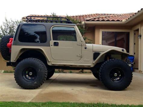 tan jeep lifted metalcloak jeep tj jeep life