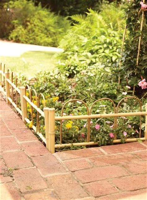this hoop bamboo fence from menards is a great way to add some character around flowerbeds or