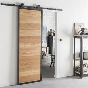 Style industriel pour une porte coulissante en bois et alu for Porte en bois coulissante