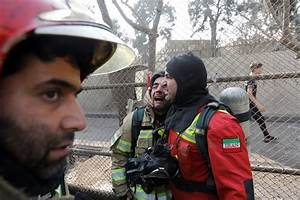Collapse of burning Tehran high-rise kills 30 firefighters ...