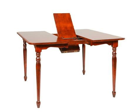 what is a butterfly leaf on a dining room table amish monarch shaker leg table with butterfly leaf