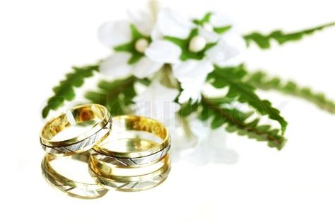 wedding rings with small flower white background colourbox
