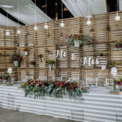 Reclaimed Wooden Pallets Make A Unique Rustic Backdrop At