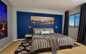 Masculine bedroom for men with blue wall decor and black