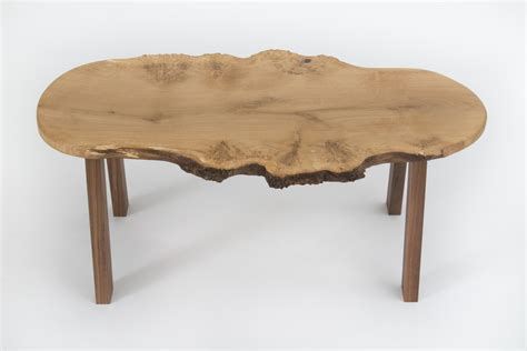 Choose a large oak coffee table with a wooden top and sleek, metal legs to add a modern twist to your living room. Small Burr Oak Live Edge Coffee Table | Bespoke Fine Furniture