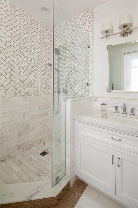 corner shower  white herringbone subway tiles