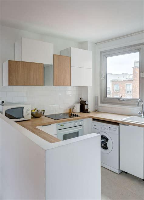 cuisine integree cuisine intégrée ouverte total look blanc et bois réaménagement d 39 un 60 m2 parisien par mon