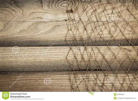 fishing net background wooden background texture and fishing net stock photo