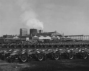 Rows Of Farmall Tractors Lined Up  Possibly Outside The