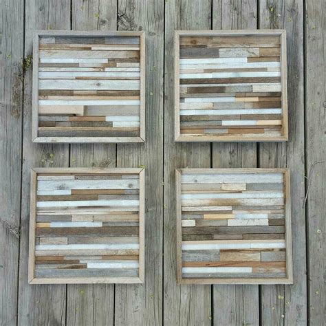 I have seen many different styles (plain wood against a white wall, painted wood on a painted wall…) and wanted to try something slightly different. Reclaimed wood slat wall arts with little bits of stone. Love this set. | Reclaimed wood wall ...