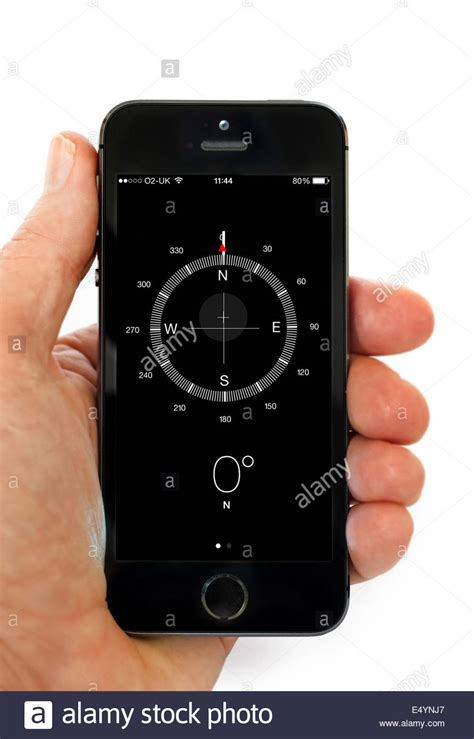 how to use iphone compass using the compass app on an apple iphone 5s stock photo