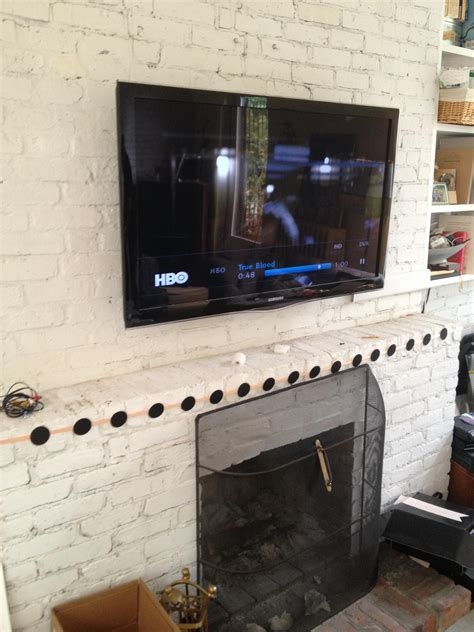inspirations   hide tv wires  brick fireplace