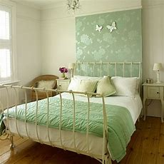 Master Bedroom With Pretty Green Feature Wall Master