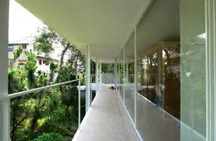 modern house balcony design glass window white exterior