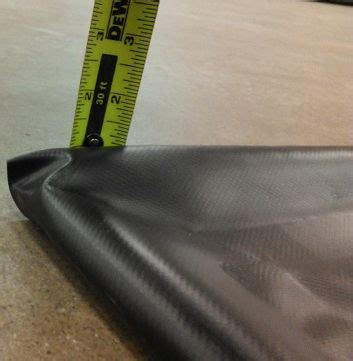 The Auto Floor Guard Garage Floor Mat has built in edges