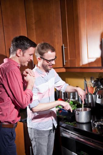 gay couple  home cooking stock photo  image