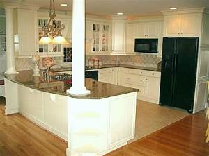 love island with columns to support wall removed between With kitchen cabinets lowes with large wall art for family room