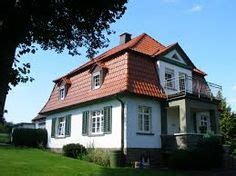 Haus Mit Mansardendach by Mansard Roof A Roof That Has Four Sloping Sides Each Of