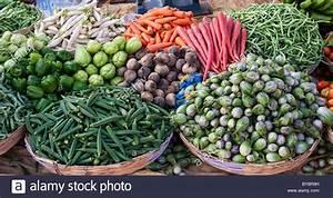 Indian vegetables in baskets at a rural village market ...