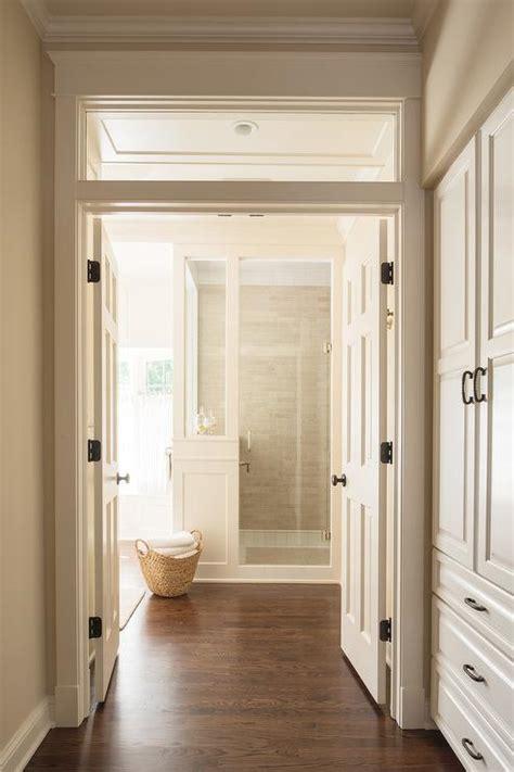 white master bathroom  dark wood trim transitional bathroom