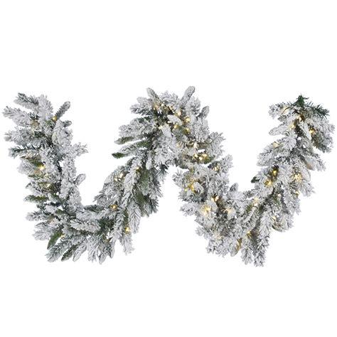 9 foot flocked snow ridge garland warm white led lights