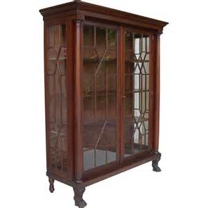 antique american empire revival mahogany breakfront china cabinet from colinreedantiques on ruby